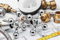 Plumbing and tools. Lying on drawing for repair Royalty Free Stock Images