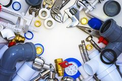 Plumbing tools and materials. Tools and materials for sanitary works, the theme of the working tool stock image