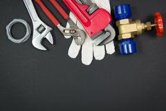 Plumbing tools and materials. Various plumbing tools and materials on white background Stock Image