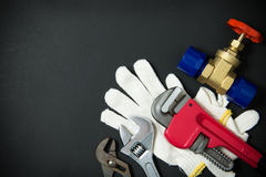Plumbing tools and materials. Various plumbing tools and materials on white background stock photos