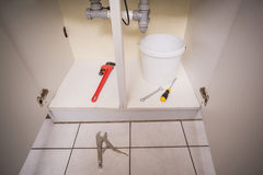Plumbing tools under the sink Royalty Free Stock Images