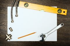 Plumbing tools on a white sheet of paper Stock Image