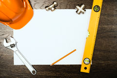 Plumbing tools on a white sheet of paper Stock Photography