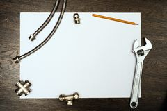 Plumbing tools on a white sheet of paper Royalty Free Stock Image