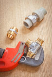 Plumbing tools on wooden board Royalty Free Stock Photo