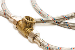 Plumbing tube in a metal sheath Royalty Free Stock Photos
