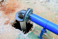 Plumbing tube New repair On the hole cement floor.  royalty free stock photography