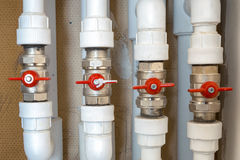 Plumbing white plastic pipes, fittings and ball valves Stock Photo