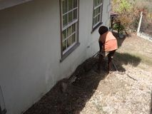 Plumbing in the windward islands. A worker fixing a blocked pipe at a home in the caribbean stock video