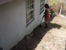 Plumbing in the windward islands. A worker fixing a blocked pipe at a home in the caribbean stock video footage