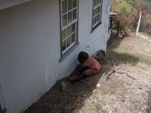 Plumbing in the windward islands. A worker fixing a blocked pipe at a home in the caribbean stock footage