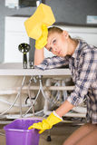 Plumbing. Woman while cleaning the floor in the bathroom stock photo