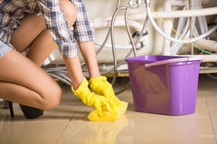Plumbing. Woman is cleaning the floor. A bucket of water royalty free stock photo