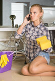 Plumbing. Woman mopping up. She is calling to plumbing stock images