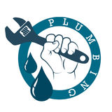 Plumbing wrench in hand Stock Photography