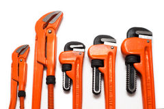 Plumbing wrenches set. Set of various size orange plumbing wrenches stock photography