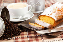Plumcake. On the table with cappuccino cup Stock Photos