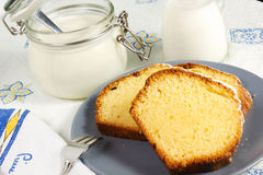 Plumcake. On the table with cappuccino cup Stock Image