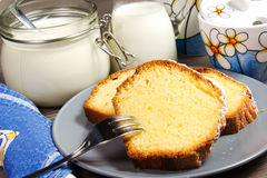 Plumcake. On the table with cappuccino cup Royalty Free Stock Images