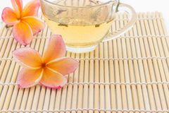 Plumeria flower and  cup of tea Royalty Free Stock Image