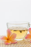 Plumeria flower and  cup of tea Royalty Free Stock Images