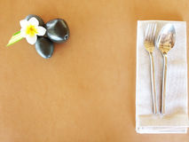 Plumeria flower top view with dinner set Royalty Free Stock Photo