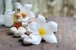 Plumeria flowers with aroma oil royalty free stock photo