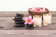Plumeria flowers, stones and candles Royalty Free Stock Photos