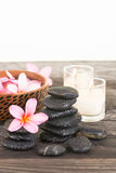 Plumeria flowers and wet black stones close-up Stock Photo