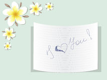 Plumeria with a note about love Stock Images