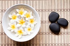 Plumeria and stone in spa Stock Images