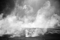 Plumes of steam rising above hot Royalty Free Stock Photography