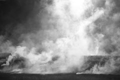 Plumes of steam rising above hot Royalty Free Stock Photos