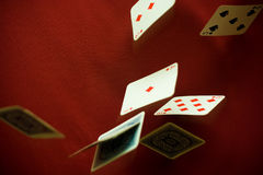 Plummeting diamonds. Action of gravity against cards Royalty Free Stock Image