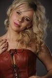 Plump beautiful woman in corset Stock Photos