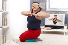 Plump female doing workout at home Royalty Free Stock Photo