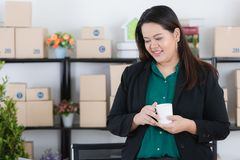 Plump lady in startup office stock image
