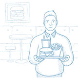 Plump man with tray full of fast food. Stock Images
