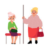 Plump middle age woman standing, old lady sitting in subway Stock Image