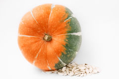 Plump pumpkin on the side with seeds CloseUp royalty free stock images