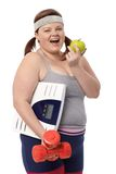 Plump woman dieting Stock Photos