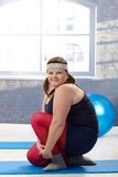 Plump woman exercising Royalty Free Stock Photo