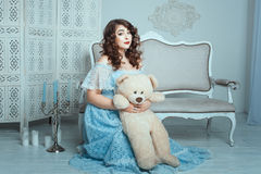 Plump woman with a toy bear. Royalty Free Stock Photo