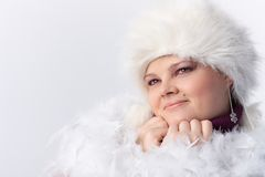 Plump woman among white feathers and fur Stock Photo