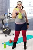 Plump young woman at the gym Royalty Free Stock Photos