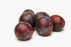 Plums. A few plums on a white background royalty free stock photos