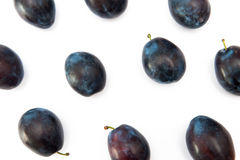 Plums. Isolated on the white background Royalty Free Stock Image