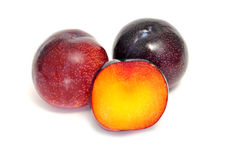 Plums. Some plums isolated on a white background Royalty Free Stock Images