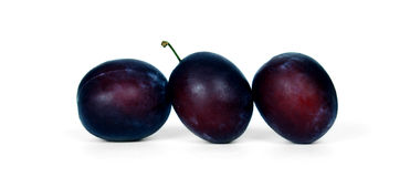 Plums. Three plums isolated on white background Royalty Free Stock Image