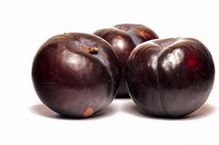Plums. Three plums isolated in white Royalty Free Stock Image